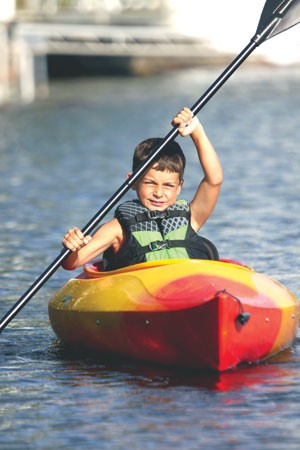 Ben Gilchris, 9, of Barton kayaks on Lake Willoughby. - SHAWN CORROW