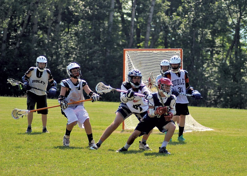 Boys playing lacrosse at Camp Dudley - COURTESY OF CAMP DUDLEY
