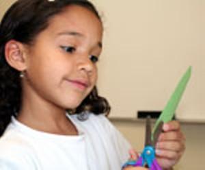 girl-making-card-scissors.jpg