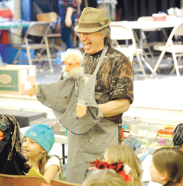 Dan Baginski instructs students on how to use their puppets