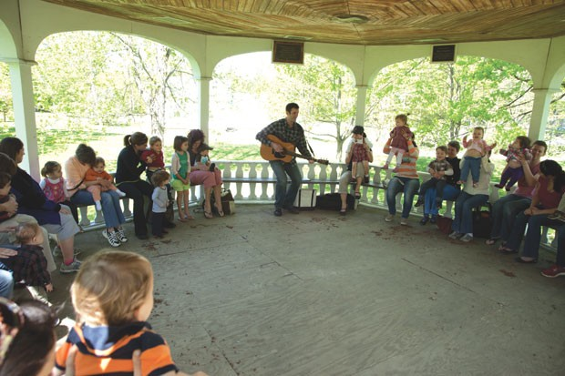 Derek Burkins leads kids in a music lesson