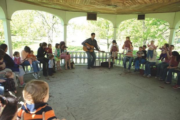 Derek Burkins leads kids in a music lesson