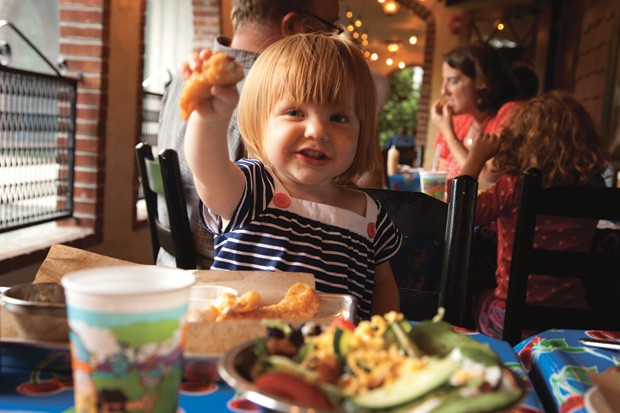 Esme Olsen eats catfish sticks for dinner at Bluebird Barbecue