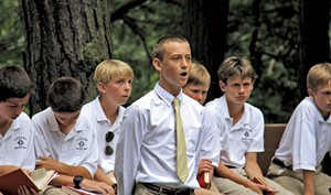 Every Sunday, the camp gathers for an outdoor chapel service by the lake where the boys can slow down and reflect on spiritual matters. - COURTESY OF CAMP DUDLEY
