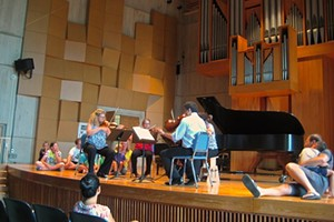 Families listen and watch at a recent concert at the UVM recital hall