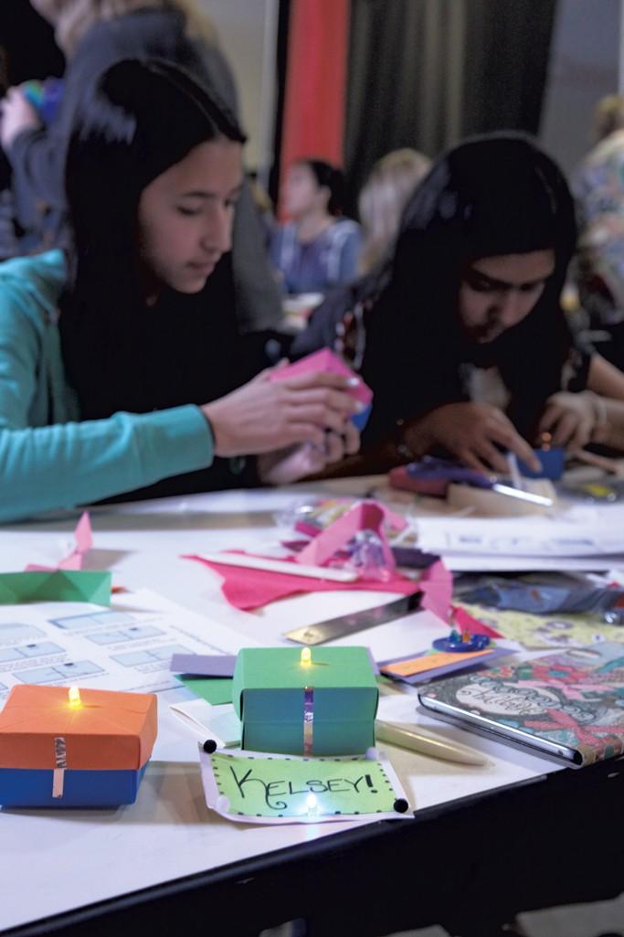 Girls create light-up boxes - MATTHEW THORSEN