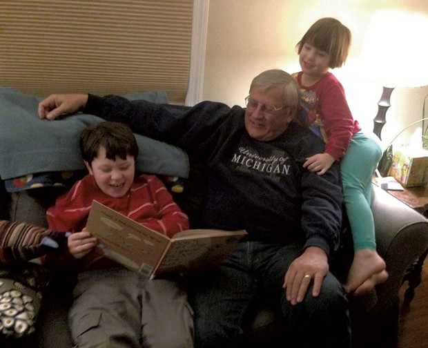 Grandpop Mike Resmer reads to Graham and Ivy