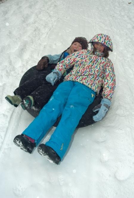 Guinevere Brownell and Kristin DeGraff tube down Mt. Philo