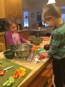 Kids chopping.