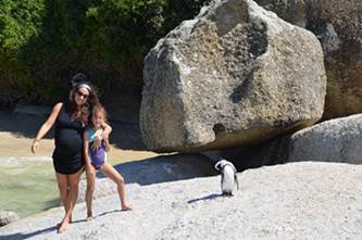 Jessica and Lola with a penguin.