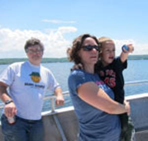 Kevin, Kate and Oliver Laddison on the Island Runner ferry to Burton Island.