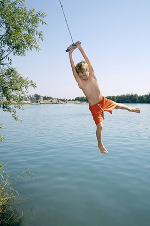 campfairpotot_boy-swing-rope-lake.jpg