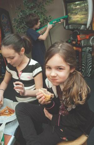 MATTHEW THORSEN - L-R Kelsey Leggett, age 9 and Kyle Leggett, age 11, of Richmond; Mercedes Rozzi, age 6, of S. Burlington.