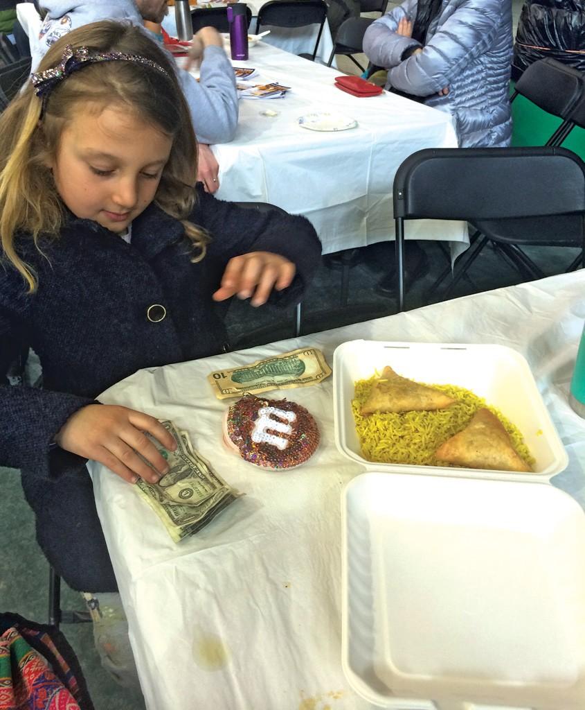Mira counts her remaining money - ALISON NOVAK