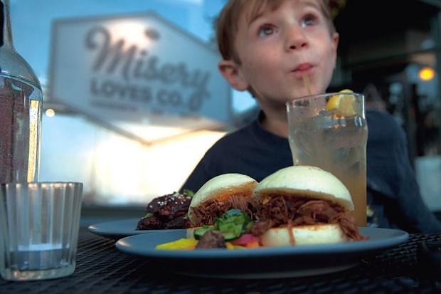Noah Bousquet enjoys the vanilla-peach soda and pork bun sliders
