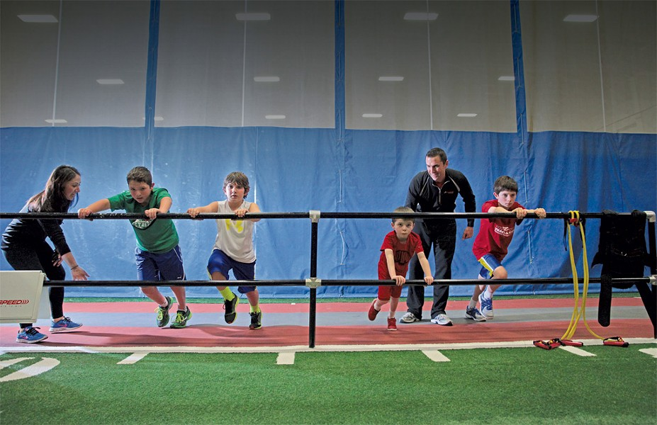 Performance coach Lauren Green and program director Mike Porter lead a Jump Start class, for ages 7 to 11, through the Wall Drive, an acceleration drill. - MATTHEW THORSEN