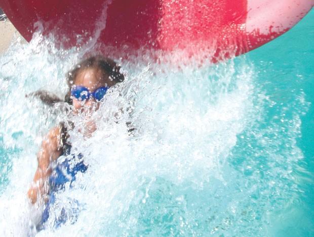 Sophia Hazard-Hayes, 6, of Burlington on the waterslide at Maple Street Pool in Essex.