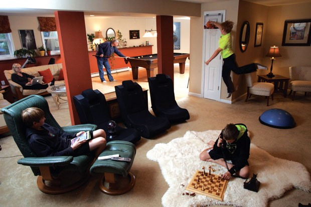 The Mitchell family hangs out in their basement game room