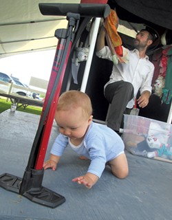 Charlie explores while his dad sets up for a performance - LANDER/FRIEDMAN