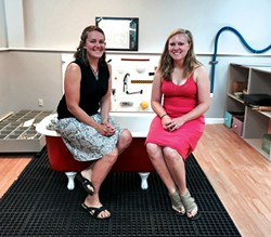 Blais and Spisiak sit on a clawfoot tub in the studio's sensory area - ALISON NOVAK