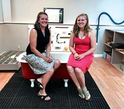 Blais and Spisiak sit on a clawfoot tub in the studio's sensory area - ALISON NOVAK