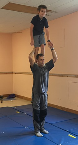 Kindar-Martin demos a shoulder stand - ALISON NOVAK