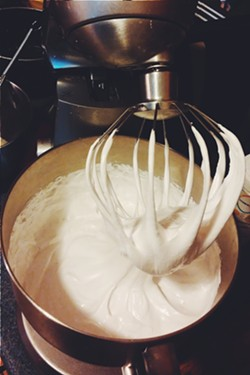Using the stand mixer to combine ingredients - ERINN SIMON