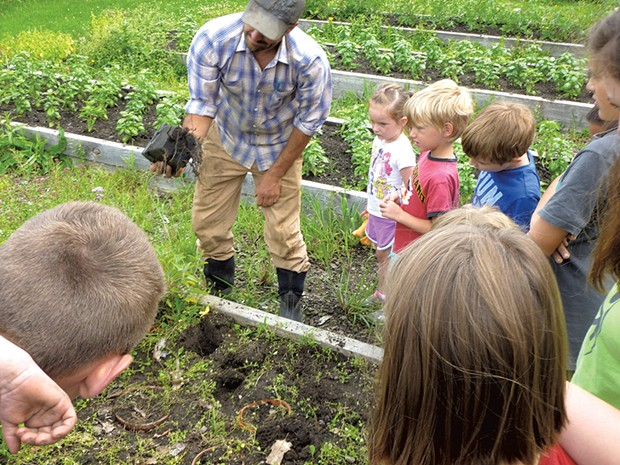 Local farmer Tucker Andrews teaching kids about the garden - COURTESY OF OCCC