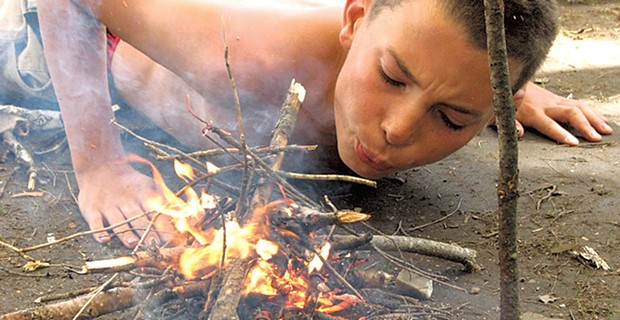 Fire building at Night Eagle Wilderness Adventures - COURTESY OF NIGHT EAGLE WILDERNESS ADVENTURES