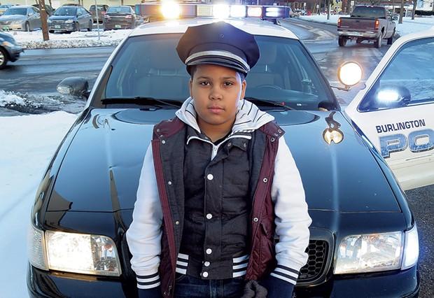 Javain Headley checks out a Burlington police cruiser. - MATTHEW THORSEN