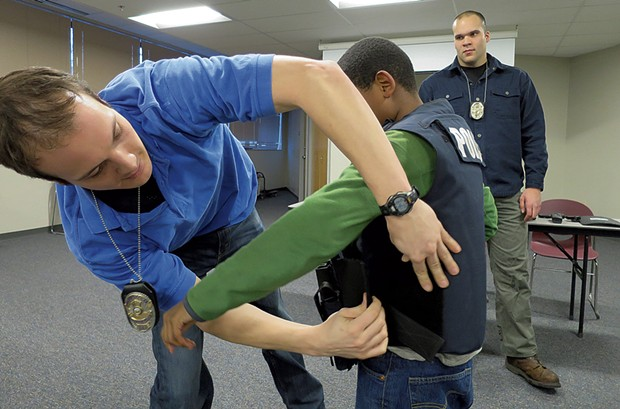 """""""What's this vest made of?"""" this boy asked. """"Kryptonite,"""" said Officer Daniel Delgado (right), straight-faced."""