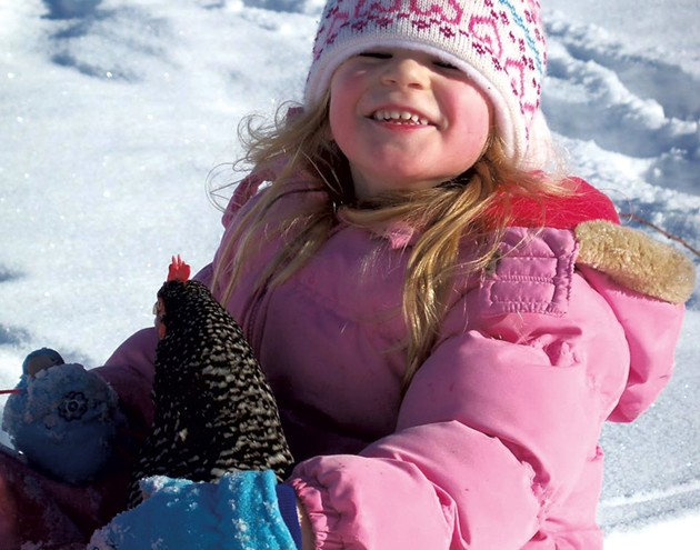 Natalee sledding with her chicken