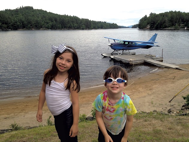 Manya and Ezra at a beach across from the Adirondack Hotel