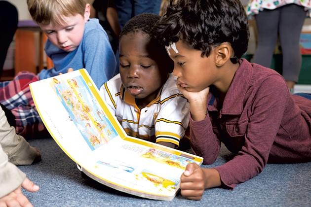 Kindergarten students at IAA reading together - SAM SIMON