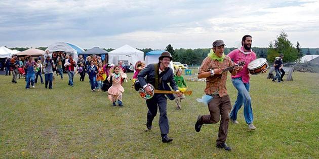 Chris Dorman leading a kids' parade at Bread & Butter Farm