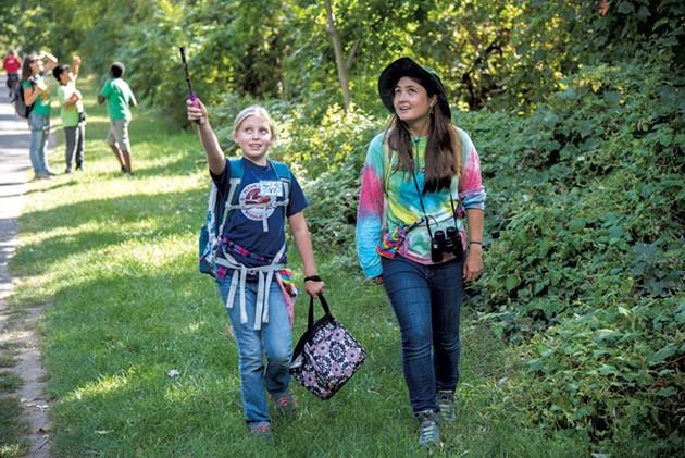UVM senior Katlyn Williard and Flynn fifth grader Ivy spot a blue jay near the Burlington Bike Path - KEN PICARD