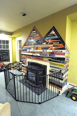25 pairs of skis were mounted behind the playroom's pellet stove - JEB WALLACE-BRODEUR