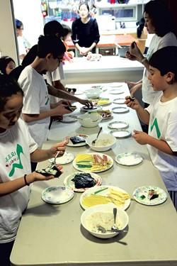 Students making kimbap - MATTHEW THORSEN