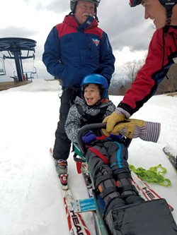 Garrett Richardson with instructor Andy Cook at Bolton Valley - COURTESY OF SMUGGLERS' NOTCH