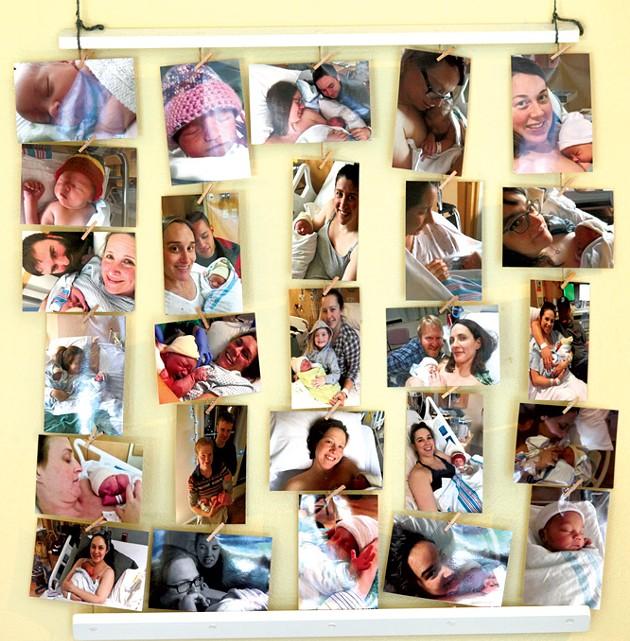 A wall of birth photos in Evolution's lobby - MATTHEW THORSEN
