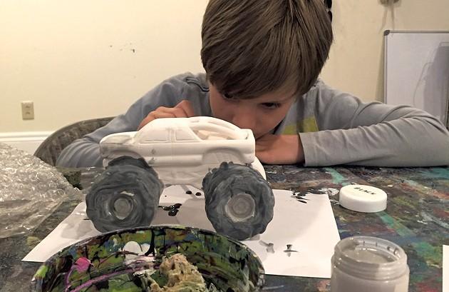 Theo paints his monster truck - ALISON NOVAK