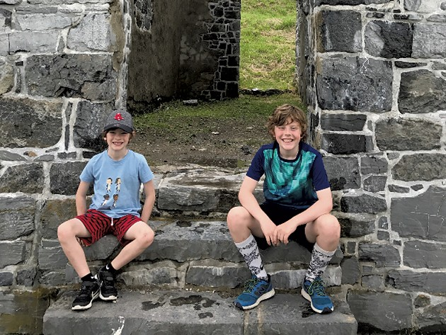 "Leo and Felix sit on the stairs of ""His Majesty's Fort of Crown Point"" - COURTESY OF BENJAMIN ROESCH"