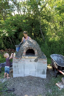 Russ and Katie build the oven - COURTESY OF KATIE TITTERTON