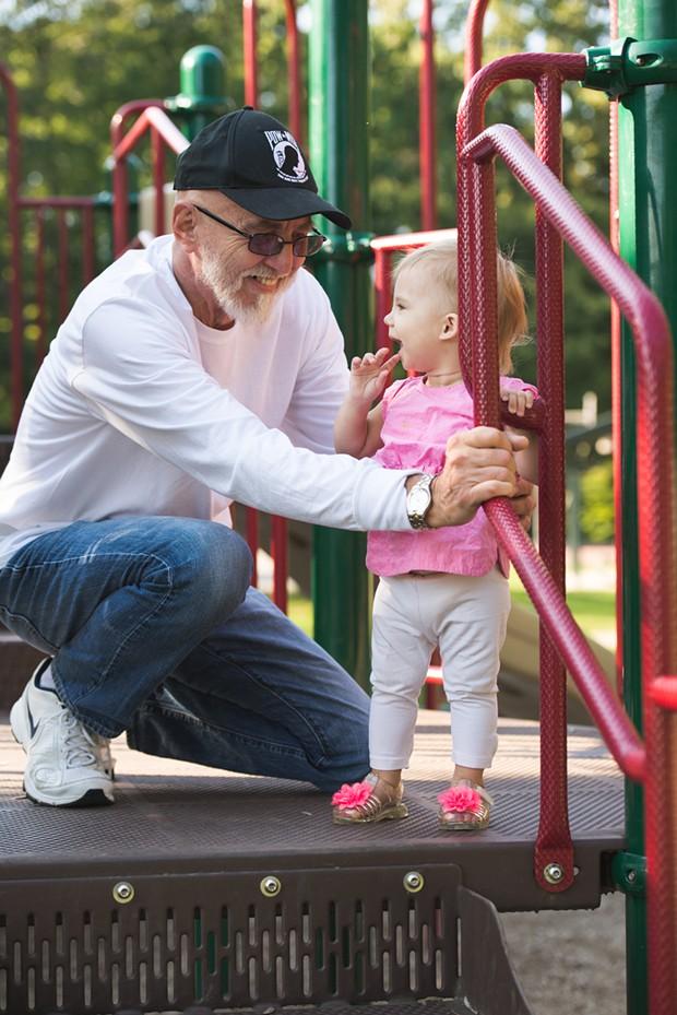Charles Zanauskas, 66, with daughter Charlotte, 1 - SAM SIMON