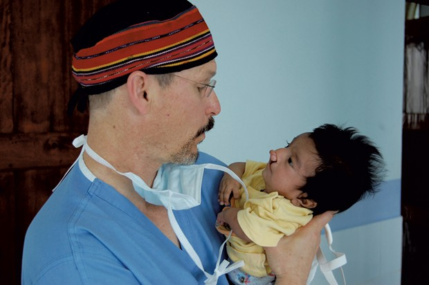Dr. Donald Laub with an overseas patient - COURTESY OF DR. LAUB