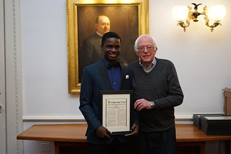 Senator Bernie Sanders with last year's second place winner Musa Muyange of Winooski High School