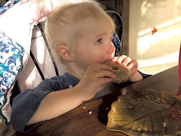 Enjoying a donut at Sweet Alchemy Bakery - KRISTEN RAVIN