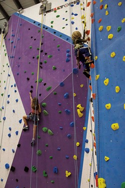 Rock wall climbers - COURTESY OF METROROCK