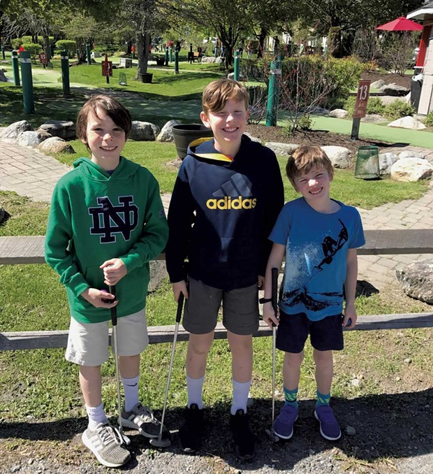 Miles, Felix and Leo get ready to golf - COURTESY OF BENJAMIN ROESCH