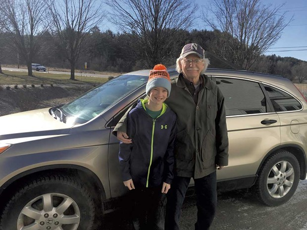 Tom Thompson with grandson Owen heading out on their last Meals on Wheels delivery in April - KIRSTEN CHENEY